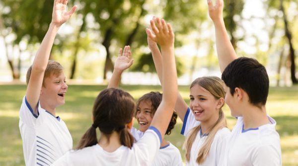 team-mates-being-happy-after-winning-a-football-match